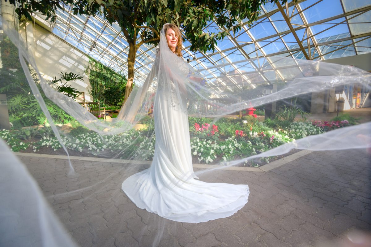Bride with veil at Foellinger-Friemann Botanical Conservatory
