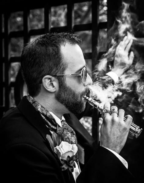 Fine art picture of Groom with vape and smoke